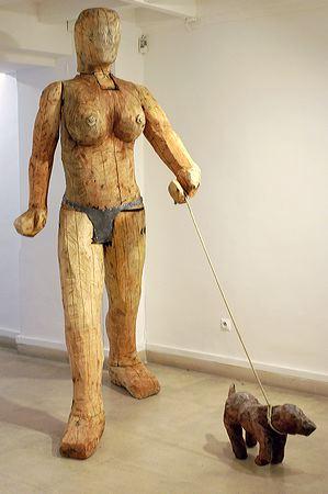 """Promeneuse"" 2004  Plane tree, douglas, cord, yew and lead 255 x 240 x 80 cm  Dog 37 x 28 65 cm"