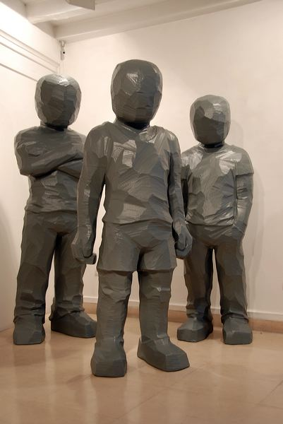 """CA 083:  """"Têtes de Lard"""", 2010  Resin of polyurethane  Figure with crossed arms: cm 200 x 70 x 50  Figure with arms along the body: cm 186 x 80 x 50  Figure with hands in the pockets: cm 182 x 60 x 50"""