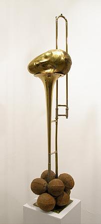 """Untitled"" (Brancusi head and trombone) 1998  1/3 bronze trombone and coconuts  cm 136 x 35 x 30"