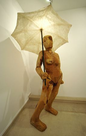 """""""Femme à l'ombrelle"""" 2004  Yew, resin and steel 255 x 150 x 150 cm"""